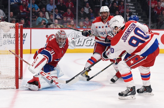 MONTREAL, QC - APRIL 2: Carey Price #31 of the Montreal Canadiens stops a shot by Marcus Johansson #90  of the Washington Capitals in the NHL game at the Bell Centre on April 2, 2015 in Montreal, Quebec, Canada. (Photo by Francois Lacasse/NHLI via Getty Images)