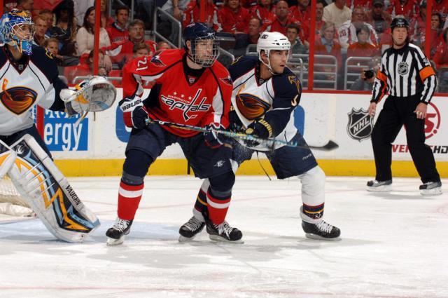 WASHINGTON - APRIL 9: Brooks Laich #21 of the Washington Capitals looks for a pass during a NHL hockey game against Mark Popovic #3 of the Atlanta Thrashers on April 9, 2010 at the Verizon Center in Washington, DC. (Photo by Mitchell Layton/NHLI via Getty Images)