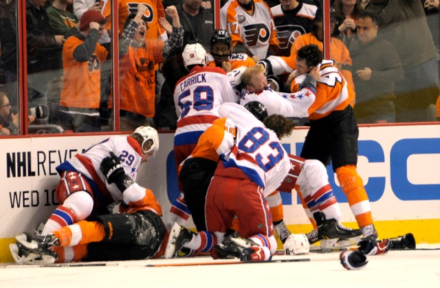 Mar 5, 2014; Philadelphia, PA, USA; Philadelphia Flyers center Vincent Lecavalier (40) and Washington Capitals defenseman John Erskine (4) fight during the first period at Wells Fargo Center. Mandatory Credit: Eric Hartline-USA TODAY Sports