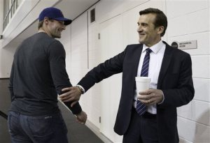 Washington Capitals former general manager George McPhee, right, talks with Washington Capitals player Troy Brouwer, in Arlington, Va., Monday, April 28, 2014. McPhee, who had just concluded a news conference, and coach Adam Oates lost their jobs with the Washington Capitals after the team failed to make the playoffs for the first time since 2007. (AP Photo)
