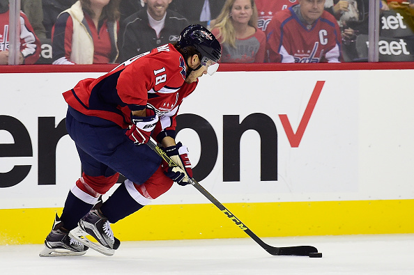 WASHINGTON, DC - OCTOBER 17: Chandler Stephenson #18 of the Washington Capitals moves the puck up ice in the third period against the Carolina Hurricanes during an NHL game at Verizon Center on October 17, 2015 in Washington, DC. (Photo by Patrick McDermott/NHLI via Getty Images)