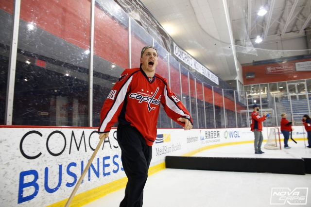 nate-schmidt-caps-washington-hockey-and-heels-scarlet-caps-jpg
