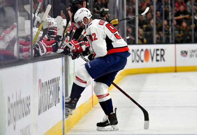 544B4EEE-E3A0-49D2-8E75-2E4AC82350FA Photo  Bruce Bennett Getty Images. Washington  Capitals top-line center Evgeny Kuznetsov left Game 2 of the Stanley Cup ... 81e7e566affe