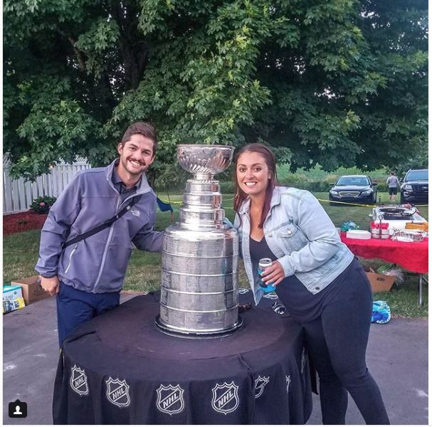 Fans with Cup Odessa Michigan